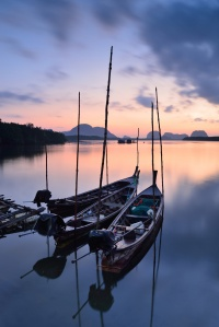 Traditional thai long tail boats at sunset ,thailand