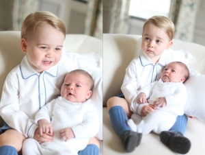 This image made available by Kensington Palace Saturday, June 6, 2015, taken by Kate, Duchess of Cambridge, at Amner Hall, eastern England in mid-May 2015 shows Britain's Princess Charlotte, right, being held by her brother, 2-year-old, Prince George. Britain's royals have been photographed by some of the world's leading photographers. But Prince William and Kate are continuing a more informal tradition begun two years ago with the first official portrait of Prince George, taken by his grandfather Michael Middleton. Charlotte was born May 2 and is fourth in line to the throne. (Duchess of Cambridge via AP) MANDATORY CREDIT /LON116/657447651338/AP PROVIDES ACCESS TO THIS HANDOUT PHOTO TO BE USED SOLELY TO ILLUSTRATE NEWS REPORTING OR COMMENTARY ON THE FACTS OR EVENTS DEPICTED IN THIS IMAGE. MANDATORY CREDIT /1506062310